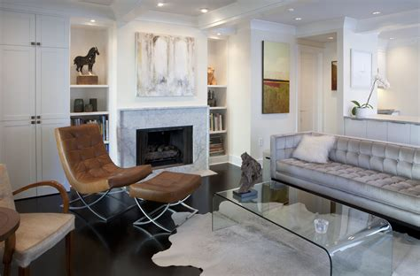 marble fireplace surround and wooden white mantel with lucite table and zebra simple stunning chair furniture modern living room living