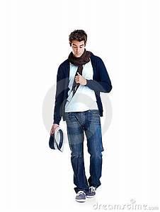 Stock Images: Stylish young man walking on white ...