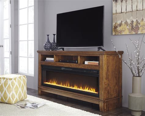 Ralene Medium Brown Xl Tv Stand With Fireplace Home Is