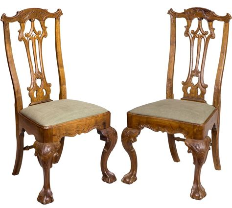 pair of carved chippendale and claw side chairs