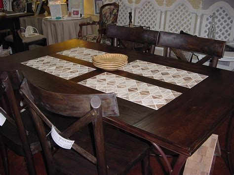 wood and tile topped dining table just