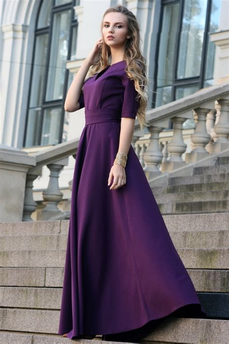 Dark purple maxi dress with circle skirts. Golden color detail in neckline