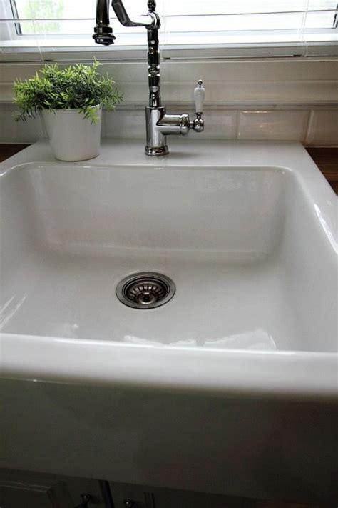 clean  white porcelain sink  creek  house