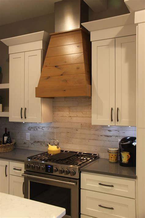 wood covered vent hood wood  ceramic tile backsplash
