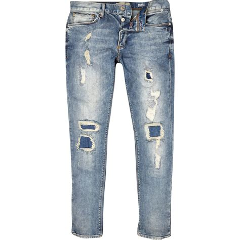 light jeans mens river island light wash ripped sid skinny stretch jeans in