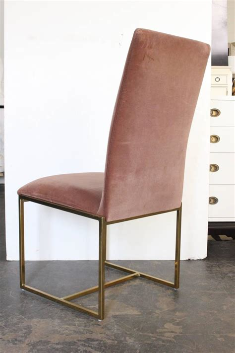 set of eight brass high back velvet dining chairs by milo