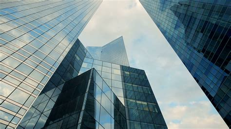building background modern glass building background time lapse clouds
