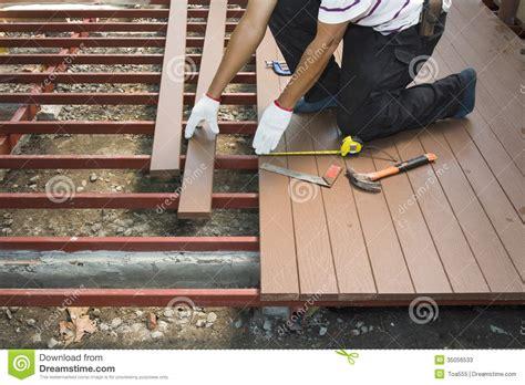 wood floor construction worker installing wood floor for patio stock image image 35056533