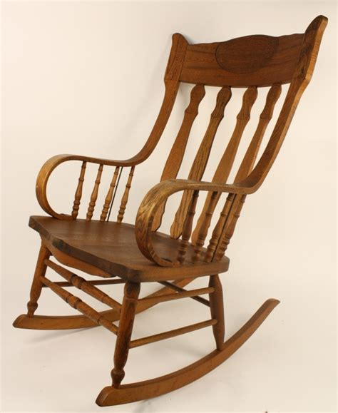 antique carved walnut rocking chair