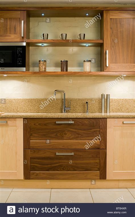 sink drawers kitchen lit shelves above sink in fitted unit with wood 6561