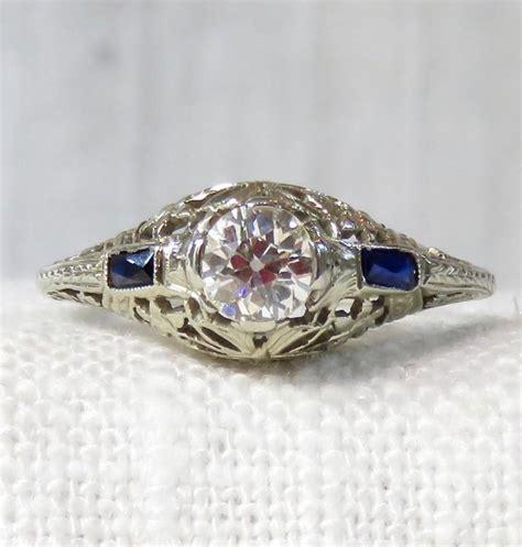 1920s 20k Gold Diamond And Sapphire Engagement Ring 54. Artisan Bracelet. Family Tree Bracelet. Dangle Ankle Bracelets. Star Wedding Rings. Training Watches. Pink Diamond Bracelet. Platinum Diamond Bracelet. Stud Necklace