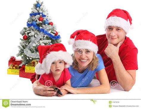 happy family in christmas hats royalty free stock photos