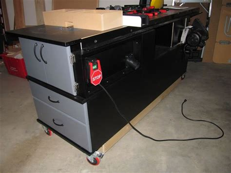 sawstop cabinet saw outfeed table my sawstop and router mobile cabinet finewoodworking
