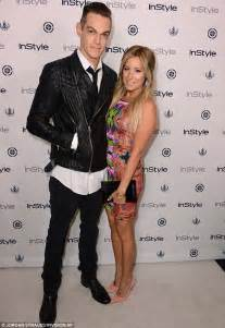 two diamond ring tisdale poses with fiance christopher and