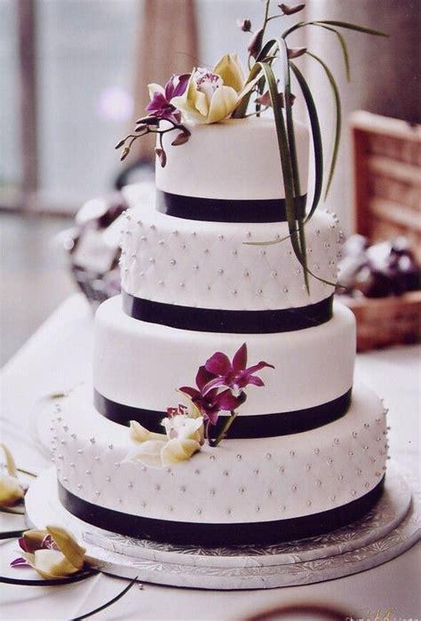 classical white wedding cake  black ribbon accent