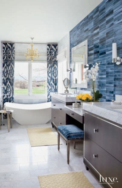 eclectic white bathroom  blue tile accent wall luxe