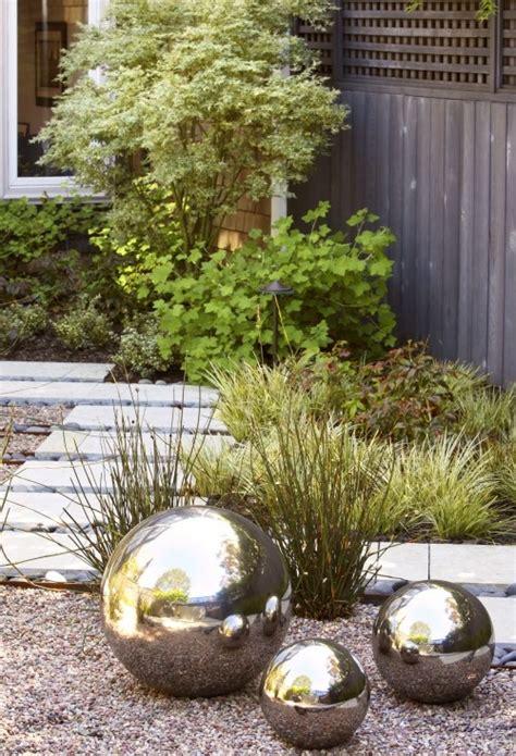 garden silver balls garden sculptures add an artistic flair to your flower bed or veggie patch better housekeeper
