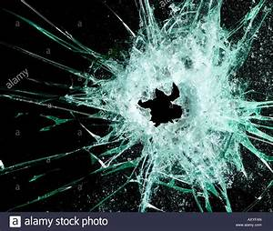 Glass with bullet hole against a black background Stock ...