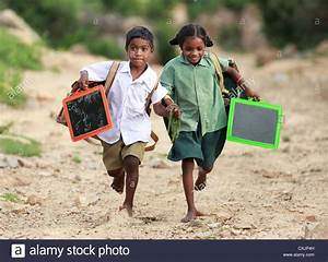 Indian school children running to go to school Andhra ...
