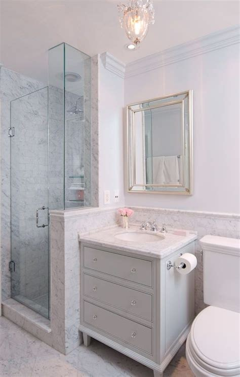 sophisticated bathroom features silver beveled mirror