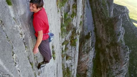 The Other Paper Free Climber Scales Rock Face