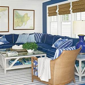 Go bold with color 40 beautiful beachy living rooms for Navy blue sectional sofa with white piping