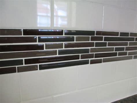 white subway tile backsplash with accent backsplash