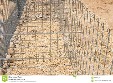 rock walls in wire mesh gabion cage under construction royalty free stock photo image 30647075
