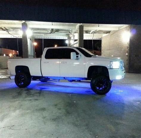 Floor For Lifted Trucks by White Chevy Lifted Truck 4 Door Led Blue Lights