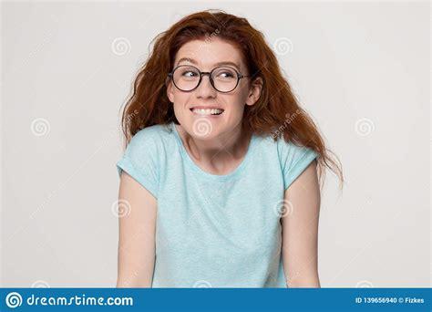 Cute Shy Redhead Girl In Glasses Biting Lips Feeling