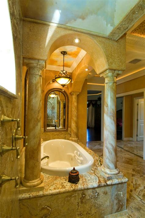 tuscan master bathroom  grand stone columns hgtv