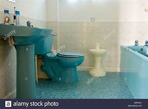 blue bathroom suite toilet bath and sink stock photo With old coloured bathroom suites
