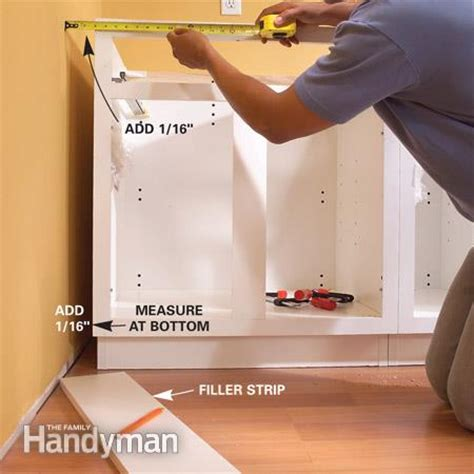 gap between cabinet and wall installing kitchen cabinets the family handyman
