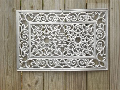 $5 black rubber door mat spray painted with silver metal