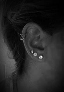 Double cartilage piercing, triple ear lobe piercing ...