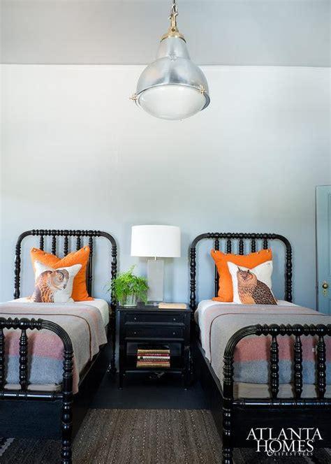shared cabin boys bedroom  black spindle beds