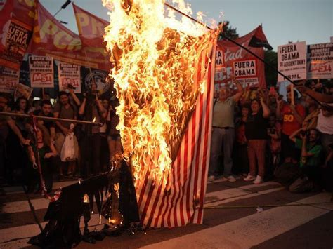 Photos: Leftist Burn American Flags to Protest Obama in ...