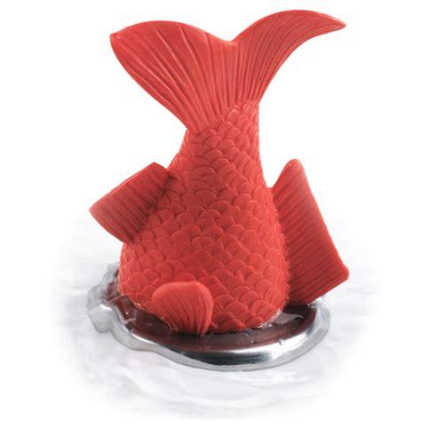 stuck goldfish bath plug the green head