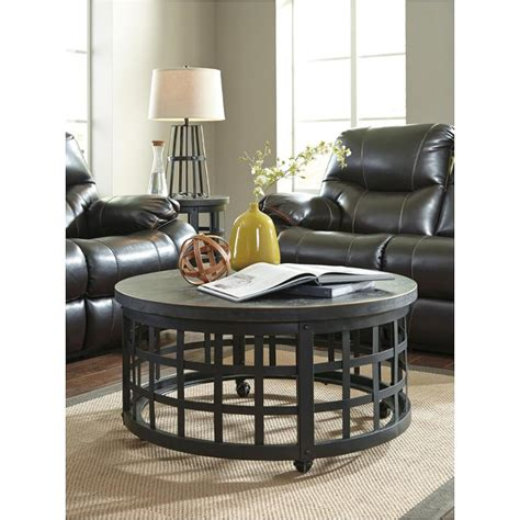 Shepherdsville traditional brown wood coffee table set. T746-8 Ashley Furniture Marimon - Black Round Cocktail Table