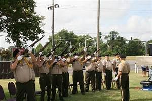 The Avoyelles Parish Honor Guard conducts a 21-gun salute ...