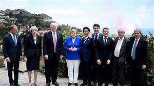 Out of step: G7 leaders take a stroll, Trump takes a golf ...