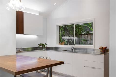 Compact Kitchens For Small Spaces by Small Contemporary Kitchen Makes Room For Home Office And