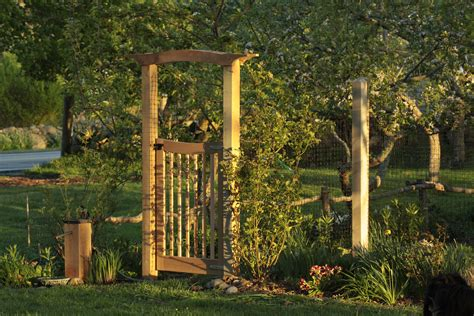 garden arbor with gate arbor gate for the vegetable garden hammer and hoe