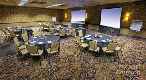 hotel conference room with tables and chairs photograph by