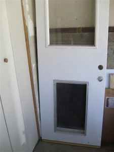 Exterior door fixed glass dog door in los angeles ca for Dog doors for sale