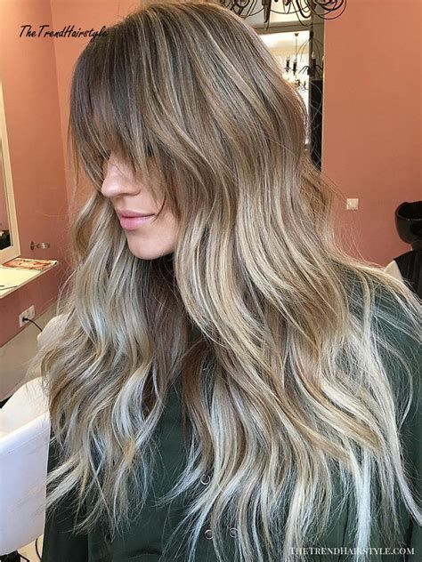 Platinum blonde is always beautiful on hair, but on this wavy bob with straight bangs, it's flirty and summery. Contouring Hairstyle - 50 Cute Long Layered Haircuts with ...