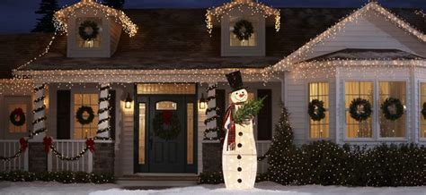 hanging christmas lights on windows outside make this the year your holiday lights go green dfd