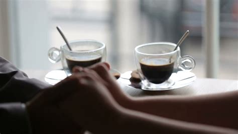 Romantic Couple Tenderly Holding Hands. Cups Of Hot Coffee Brazilian Coffee Exporters Council Nespresso Pods At Waitrose Myer Wood Flooring Grams Target Online Canadian - Etobicoke On