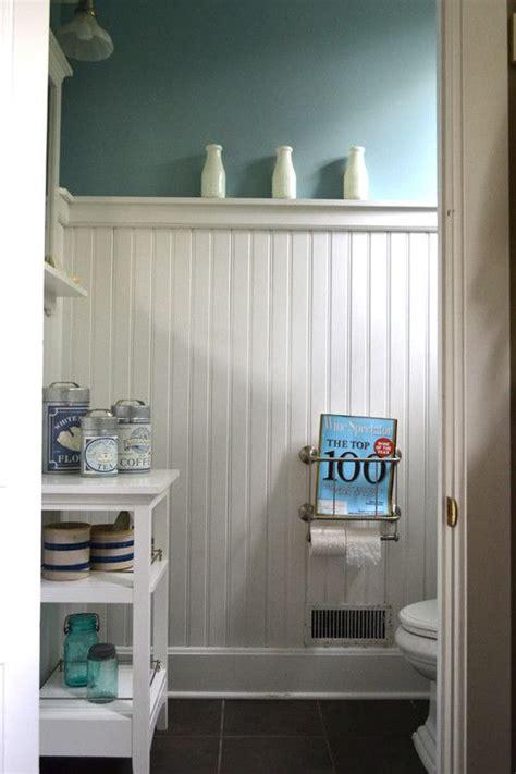 aqua color above white wainscot in the bathroom