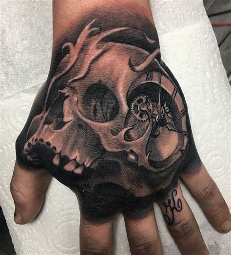 hand skull tattoo inkstylemag